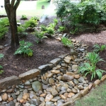 landscape drainage solutions and dry creek bed landscaping