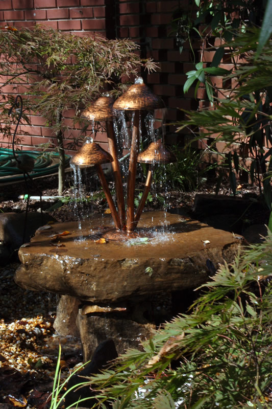 landscaping water features and dripping rocks